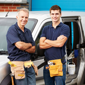 two service techs standing in front of van